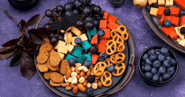 nuts, cheese and pretzels snack board