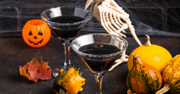 black Halloween cocktail in glass