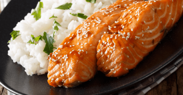 salmon with rice on a plate