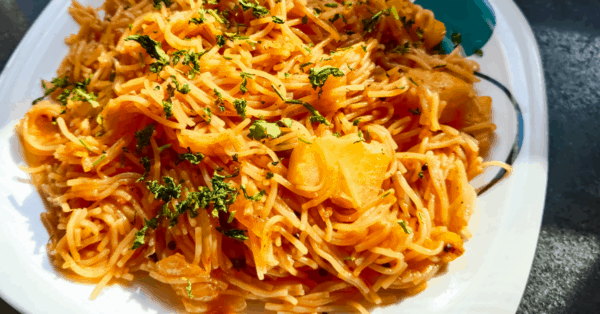 spaghetti and vegetables on a plate