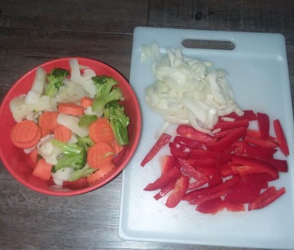 cut vegetables, onion and red peppers