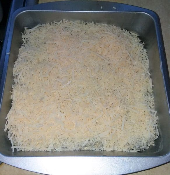 spinach dip and parmesan cheese in baking dish