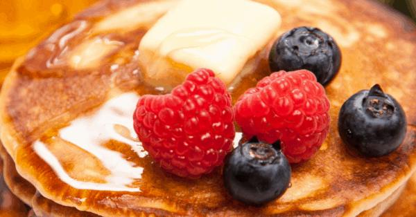 pancakes, raspberries, blueberries, butter