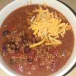 chili in a bowl topped with cheese